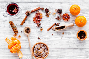 Ingredients mulled wine or grog with spices and citrus for winter evening. Christmas new year eve. Wooden background top view.