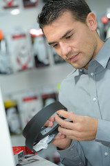 man checking product in store