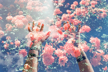 Double exposure hands and flowers