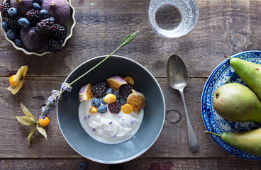 Yogurt flavored with lavender and served with fruits.