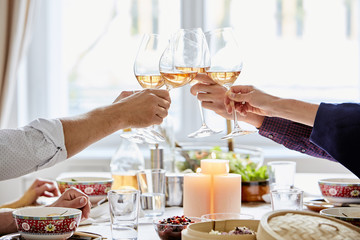 Friends Toasting Wine Glasses At Dining Table
