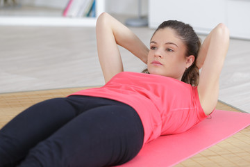 beautiful doing sit ups on the mattress at home