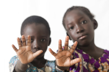 African children showing hand palms as a stop sign, isolated on white