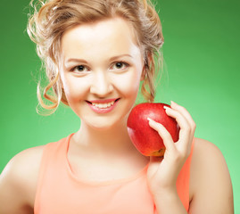 beautiful  woman with red apple in hand