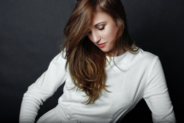 profile portaitf of a beautiful girl in white clothes