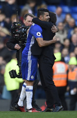 Chelsea manager Antonio Conte celebrates after the game with Diego Costa