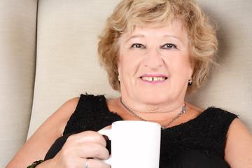 Old woman drinking coffee.