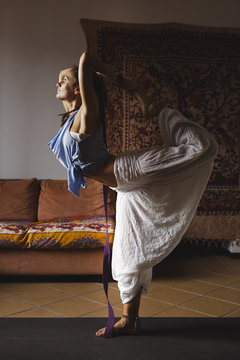 Woman in dance pose at home