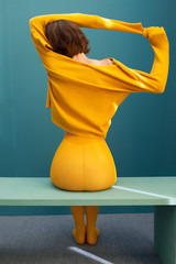 Young woman with yellow clothes
