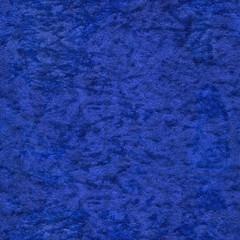 Background of dark blue suede fabric closeup. Velvet matt texture of navy blue nubuck textile.High-resolution seamless texture