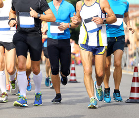 athletes during the marathon on the road
