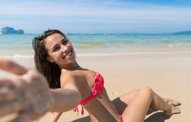 Attractive Young Caucasian Woman In Swimsuit Sitting On Beach, Girl Taking Selfie Photo Blue Sea Water Holiday Summer Vacation