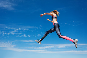 Sportswoman remains in air while jumping