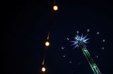 People ride a merry-go-round at a funfair in central London