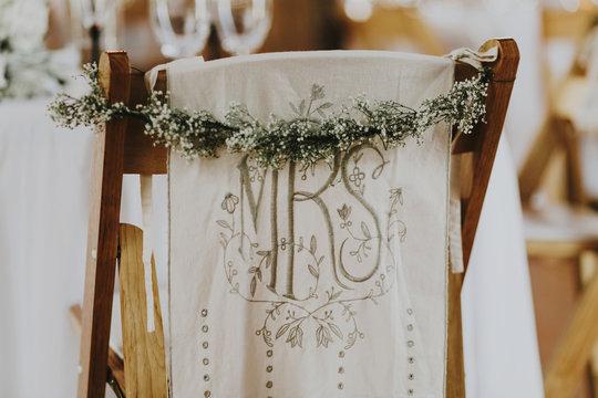 Decorated Wedding Reception Chair in Barn Reception Venue