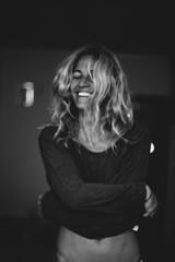 Beautiful smiling woman taking off a t-shirt