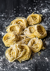 Fresh pasta on floured cement surface