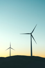 Pair of windmills at sunset