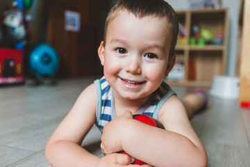 Happy Male Toddler at Home Looking at Camera