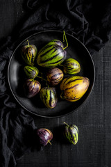 Pear-melons on a black wooden table