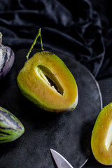 Pear-melons on a wooden  table