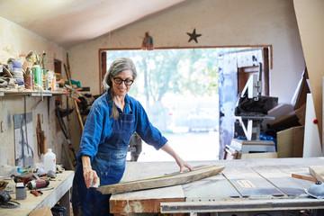Portrait of senior woman inside her wood shop
