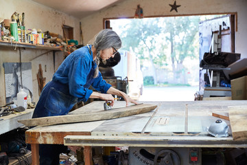 Portrait of senior woman inside her wood shop