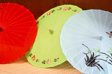 Japanese traditional umbrellas different colors,red,blue,green.