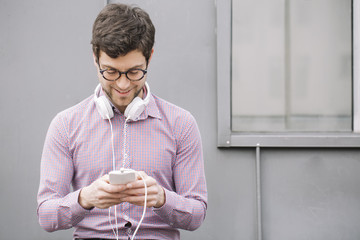 Young man with headphone using his smartphone