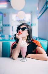 pin up woman having a milkshake