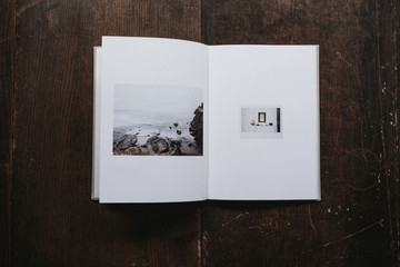 open book with photos of coast