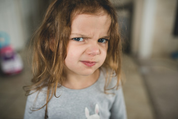 Young girl giving silly faces