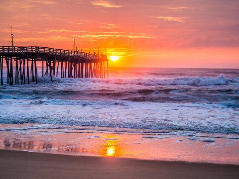 Sunrise over fishing pier at North Carolina Outer Banks
