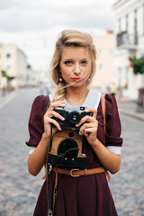 Vintage style blonde girl with retro camera