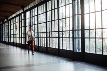 Businessman Walking by Glass Doors