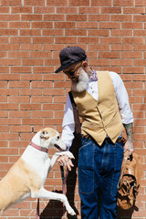 Stylish Old Man With Tattoos With His Pet . Dog