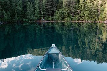 Bow of a canoe pointing toward a campsite