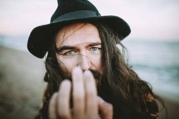 portrait of a long haired man