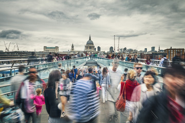 People in Motion On Millennium Bridge in London City, UK Fotobehang