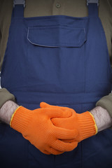 working hands in orange gloves