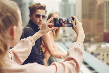 Group of young people who posing for mobile photography