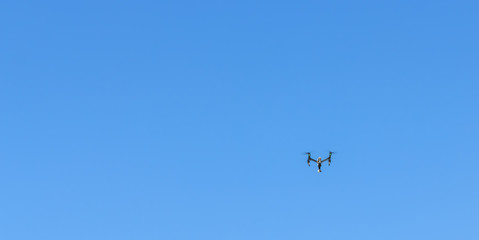 Drones flying in the sky for shooting video.