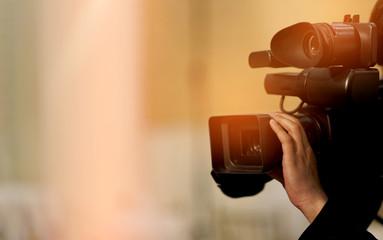 videographer / professional camera / man with camera