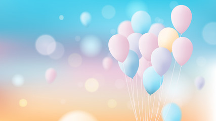 Bunch of colorful pastel balloons flying over bright sky