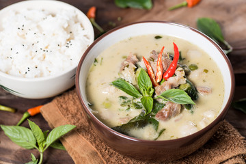 Thai food (Kaeng Khiao Wan),Green curry with pork and cooked rice on wooden background