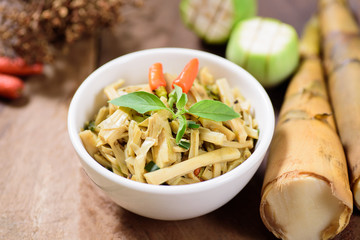 Thai Northern food (Yum Nor Mai),spicy bamboo shoot salad with crab paste on wooden background
