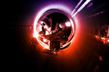 Pipe welding on the pipeline construction (welder)