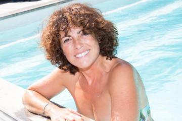 smiling Woman Having Fun In Swimming Pool