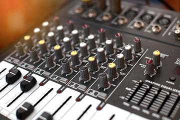 Closeup of an audio sound mixer.