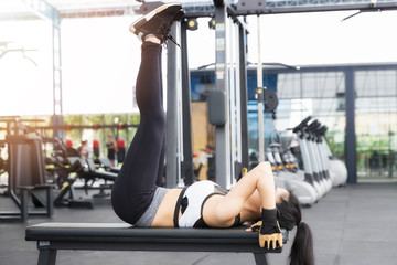 Closeup of a young fitness asian woman workout at sport club.